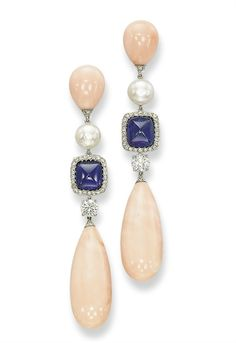 A PAIR OF CORAL, SAPPHIRE, NATURAL PEARL AND DIAMOND EAR PENDANTS, BY MICHELE DELLA VALLE Each designed as an articulated line, the elongated drop-shaped coral suspended from a circular-cut diamond, a diamond bordered sugarloaf sapphire, and a natural button pearl, to the coral drop surmount, mounted in 18k white gold, 8.0 cm long, in a Michele della Valle white suede box