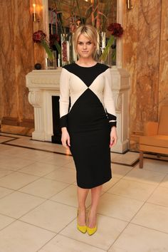 Alice-Eve-paired-her-black--white-sheath-bold-yellow-pumps