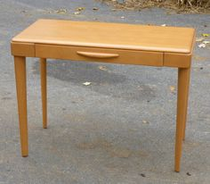 """Sold in Nov. 2013 for $500.    RARE Heywood Wakefield Table Desk - M327W -  item: M 327 W - Table Desk - produced between 1950 and 1954.  - recently refinished to the original CHAMPAGNE finish.  Measures 40"""" by 20"""" by 30"""" high."""