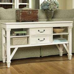 Wood console table with 2 center drawers and 4 side shelves.     Product: Console tableConstruction Material: P...