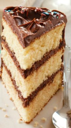 Classic Yellow Cake with Chocolate Frosting Recipe ~ A fluffy yellow (3 layered) cake with the creamiest chocolate frosting, is a classic made from scratch