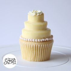 Skip the wedding cake for these vanilla cupcakes topped with cheesecake and white chocolate mirror glaze.