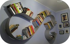 Metal curved shelving: Bookworm kartell#2 via Andrea Angioletti | Flickr - Photo Sharing!