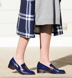 Glossy blue finish loafer with metallic fringe detail. Pair this with sleek navy tones or hints of metallic. Turkey loafer by Bared Footwear.