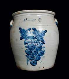 """Price Realized: $ 2,875.00 Exceptional Six-Gallon Stoneware Cream Jar with Grapes Decoration, Stamped """"COWDEN & WILCOX / HARRISBURG, PA,"""" circa 1865, ovoid jar with tooled shoulder, finely-thrown rim, and applied lug handles, decorated with a very large decoration of a cluster of grapes hanging from a vine with two leaves and two corkscrewing tendrils. A rare and impressive size for Harrisburg stoneware, featuring a desirable motif in excellent color. Pro"""