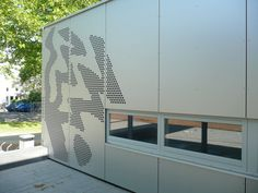 Wood fiber cladding / smooth / perforated / panel - YOUTH CLUB SONTHEIM - Bruag