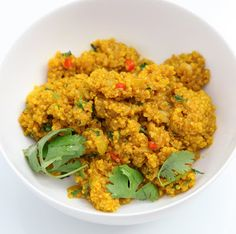Tumeric Curried Quinoa 1 cup Quinoa, rinsed in a fine mesh strainer 2 Tbsp. natural red palm oil 3/4 onion, diced 1 tsp. fresh ginger, grated 2 red hot chili peppers, finely sliced 1 1/2 Tsp. tumeric 1 1/2 tsp. ground coriander 1/4 tsp. cinnamon 1 3/4 cups water 1 tsp. salt 1 handful fresh cilantro, chopped