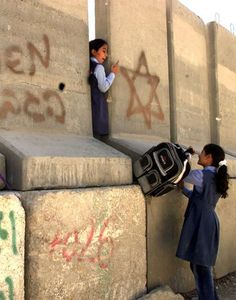 Two palestinian girls trying to go to school