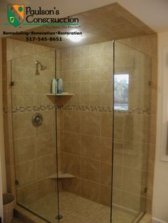 Tiled shower with accent glass tile strip.