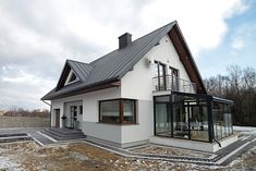 Polish architects Biuro Projektowe MTM STYL have taken a classic family home and turned it into the sweetest little space that you'll ever find. Future House, Double Storey House, Hotel Lounge, Attic Renovation, Dream House Exterior, Facade House, Cottage Homes, Modern House Design, Home Fashion