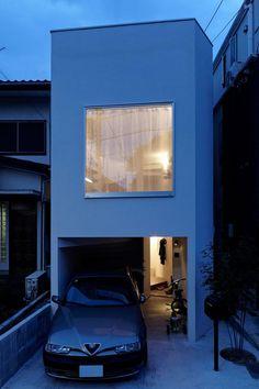 Akihisa Hirata designed an ingenious S-shaped residence on a narrow site in Japan. Developed vertically, this unusual family home has a simple rectangular exterior shape. All the interiors wrap around a massive stairway supported by three pillars, which leads the way towards the top floor. #homedesign