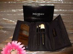Yves Saint Laurent YSL Make-up Cosmetic Brush Set with Portable Case with Mirror by Yves Sait Laurent. $59.99. magnetic closure. Rare and Hard to Find. Case has a zippered pocket and mirror. Includes 3 brushes. Each brush has Yves Saint Laurent signature on the handle. Classic & very elegant portable brush  make up set. Comes with folding pouch,mirror and 3 essentials brushes: Lips/Shadows/powder-blush. Great size very detailed design. It a must for every woman' s ...