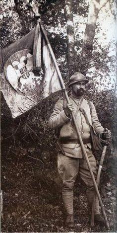 Serbian soldier holds the regimental flag