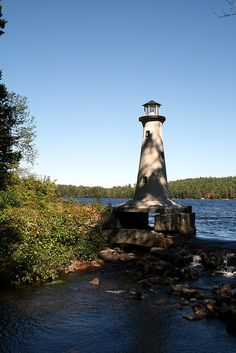 This tiny (perhaps 10 foot high) lighthouse stands on the shore of Potanipo Lake in Brookline, NH.