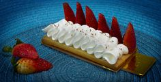 crunchy cookie with some cream and strawberries