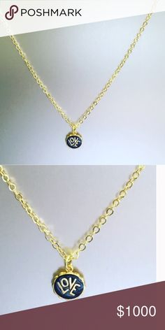 "LOVE this Love Charm Necklace comes in gift box Gold/Black Enamel. Charm is gold plated with black enamel measures 5/8"" wide and 1/2"" tall from top of O to bottom. Chain length is 16"" plus 2"" extension.   Comes with a gift box Jessica Elliot Jewelry Necklaces"