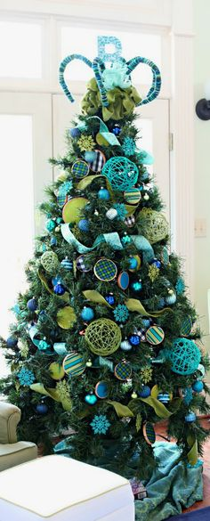 But if you truly want to stand out, we'd suggest you go for a blue Christmas tree this year. we've gathered a list of blue Christmas tree decoration ideas. Blue Christmas Tree Decorations, Creative Christmas Trees, Beautiful Christmas Trees, Peacock Christmas Tree, Ball Decorations, Xmas Trees, Whimsical Christmas, Holiday Tree, Christmas Ornaments