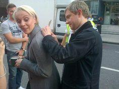 Martin using Amanda's back to sign autographs.