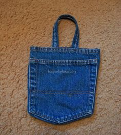 Make a phone charger pouch out of the pocket of an old pair of jeans!  Portable, washable, and keeps that wiry cord in place.