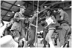 Luscious, mini-skirted screen-queen Raquel Welch gets help from four enthusiastic GIs as she performs on the Bob Hope Show at Da Nang military base December 18th, 1967। Beautiful Raquel was one of the performers accompanying the popular comedian on his annual overseas Christmas tour that year.