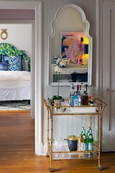 Bar Carts: When done right, designer Lindsay Pennington says these pieces can be useful — but people often come across the same problem as open shelving. Click through of more decorating trends designers wish would go away.