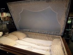 The story behind this custom coffin is that a couple's infant daughter died, and they agreed to commit suicide and be buried with the daughter. At the last minute, they backed-out and never picked up the coffin from the coffin-maker. Here it rests at the National Museum of Funeral History, Houston