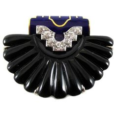 Cartier New York Art Deco Onyx Enamel Shell Clip | From a unique collection of vintage brooches at https://www.1stdibs.com/jewelry/brooches/brooches/