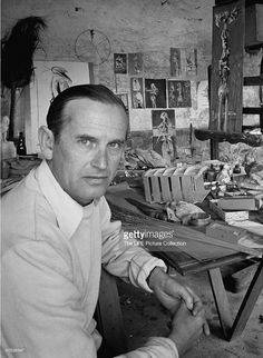 Artist Graham Sutherland sitting in his studio in the South of France, with his work behind him. Artist Studios, South Of France, Surrealism, Graham, Artists, Space, Fictional Characters, Pintura, Floor Space