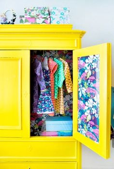 Bright yellow wardrobe with vintage wallpaper. Superb way to use old furniture in a funky space.