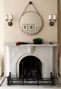 Another round mirror inspiration pic via the handmade home. I'm really digging the mantle too