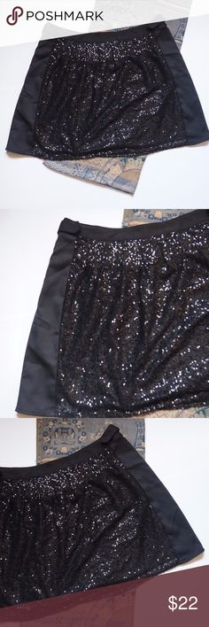 """I Heart Ronson Black Sequin Party Skirt Size 14 Hello! Up for sale is this I Heart Ronson Black Sequin Skirt in size 14 in good pre-loved condition. Please view all photos and measurements to ensure your perfect fit before purchase. Please let me know if you have any questions! :)   Material  100% Polyester - No stretch.  Hand Wash   Measurements Waist - 18"""" Top-Bottom - 19"""" Hips - 23"""" I heart Ronson Skirts"""