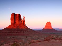 Sandstone buttes known as the Mittens tower over the desert floor in Monument Valley Navajo Tribal Park, Arizona. [Photo by Katrina Brown, My Shot]