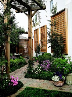 Tall Pergola  When building a pergola, consider how the width, height, and depth will work in your overall landscape. This tall pergola in a narrow side yard is in perfect scale with the home and adds an impressive shady resting spot along the path.