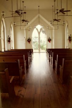 The Christians are the Church, and The Church is the Bride of Christ. [beautiful photo of a church with wooden floor and pews and white walls with Christmas wreaths hanging on them and sunlight streaming in through a large window] Churches Of Christ, Old Churches, Architecture Religieuse, Preachers Wife, Altar, Old Country Churches, Minimalist Christmas, White Christmas, Take Me To Church