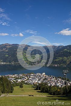 #View From #Schmittenhöhe To #ZellAmSee & #Lake #Zell @dreamstime #dreamstime #nature #landscape #austria #salzburg #panorama #season #travel #summer #autumn #fall #vacation #holidays #sightseeing #alps #leisure #bluesky #beautiful #colorful #wonderful #mountains #stock #photo #portfolio #download #hires #royaltyfree Zell Am See, Salzburg, Autumn Fall, Alps, My Images, Sunny Days, Austria, Fair Grounds, Colorful