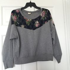Gray sweater with laced flowers on front Very cute and classy or casual with the laced flowers. Love tree Sweaters