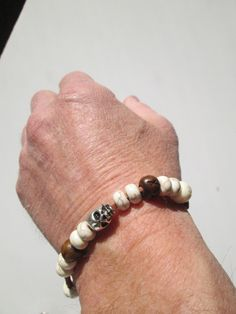 Surfer, Boho, Hippie style Bracelet featuring Leather a silver colored Skull, white howlite stone beads and silver beads Available at SpuzzoWoodworking com