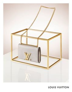 COPPI BARBIERI.  Fashion.  Still Life.  Handbag.  Louis Vitton.  Gold Plinth.