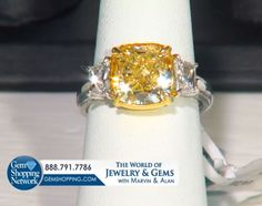 Exquisite fancy yellow diamond ring with two white diamond side stones set in two tone gold (yellow gold and white gold). This fancy colored diamond ring is an exceptional engagement ring for your perfect proposal. To see more jewelry and gemstones tune in to Gem Shopping Network 24/7.