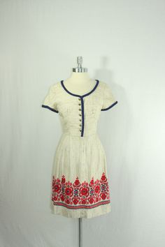 1950s Dress - Vintage Tweed Like Scandinavian Frock with Bold Red and Navy Floral Border Print. $90.00, via Etsy.