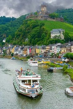 Cochem, Germany, and the Mosel River with Cochem Castle in the background. Cochem Castle is the largest hill-castle on the Mosel. Towering and richly decorated, the hill-top castle has stunning panoramic views from its restaurant. Places Around The World, The Places Youll Go, Travel Around The World, Places To Visit, Around The Worlds, Wonderful Places, Beautiful Places, Beautiful Pictures, Rhine River Cruise