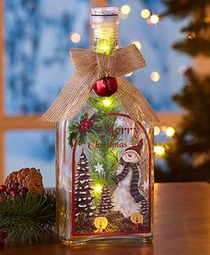 Lighted Vintage Glass Bottles This Lighted Vintage Glass Bottle is a delightful combination of the old and the new. Nostalgic-style artwork is applied to a bottle with modern LED lights insi Wine Bottle Art, Painted Wine Bottles, Wine Bottle Crafts, Unique Christmas Decorations, Snowman Decorations, Holiday Decor, Shelf Decorations, Merry Christmas, Christmas Crafts