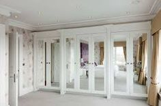 Attractive White Master Bedroom Closet Ideas in the Contemporary Bedroom with Mirrored Closet Doors and White Ceiling Bedroom Closet Doors, Mirror Closet Doors, Bedroom Wardrobe, Wardrobe Doors, Mirror Door, Master Closet, Mirror Shelves, Mirror Bedroom, Sliding Wardrobe