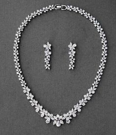 A bridal necklace set with classic styled marquise and teardrop CZ jewels. Earrings are approximately inches long, post backs, the necklace is 16 inches with a locking clasp. Grade AAA CZ, rhodium or rose gold plated, nickel and lead free. Diamond Choker, Diamond Solitaire Necklace, Diamond Pendant, Dimond Necklace, Garnet Necklace, Diamond Bracelets, Diamond Necklace Simple, Onyx Necklace, Layered Necklace