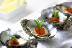 fresh oyster with fish roe (tobikko) and shallot by pvcpvc, via Flickr