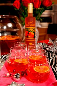 Pomagrenade Punch: 1 cup @Vanessa Worrall Gogh Vodka Pomegranate, 1 fresh red hot chili, seeded and sliced paper thin, 2 large pomegranates, seeded, 1/2 cup pomegranate juice, 1 bottle chilled champagne or sparkling wine, 4 mandarins, finely sliced, 1/4 cup maple syrup (optional - depending on desired sweetness), ice; Directions: In a large bowl combine pomegranate vodka, chili, and pomegranate seeds. Cover and marinate in fridge for 30 minutes. Add the rest of ingredients when ready to…