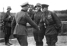 German and Soviet army officers pictured shaking hands—after Nazi Germany and Soviet Union annexed new territories in Eastern Europe, 1939.