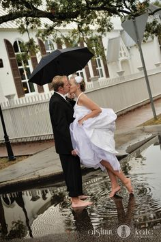 Rainy day wedding puddle (pensacola, florida). Such a cute idea. Find umbrellas for rent and/or sale at splendorforyourguests.com!  Splendor for Your Guests | Rental Company | Weddings | Events | Shawls | Blankets | Umbrellas | Parasols | Fans