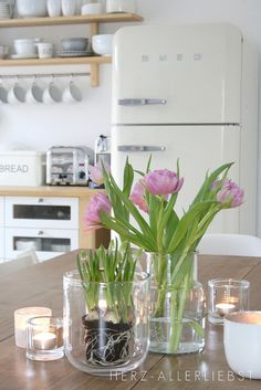 white kitchen with pink/green accent
