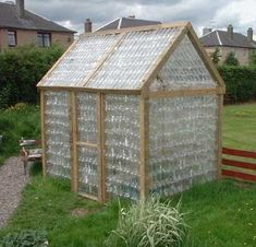A backyard greenhouse made from a simple timber frame & hundreds of recycled plastic bottles! Plastic Bottle Greenhouse, Reuse Plastic Bottles, Diy Greenhouse, Recycled Bottles, Plastic Glass, Plastic Containers, Outdoor Projects, Garden Projects, Outdoor Spaces